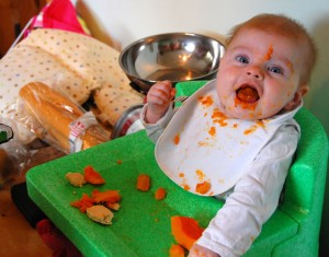 Izzy making a mess with butternut squash!